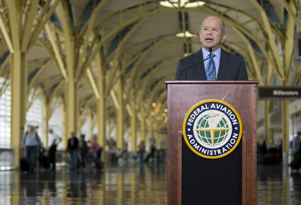 Photo - Federal Aviation Administration (FAA) Administrator Michael Huerta announces that government safety rules are changing to let airline passengers use most electronic devices from gate-to-gate during a news conference, Thursday, Oct. 31, 2013, at Washington's Ronald Reagan National Airport. The change will let passengers read, work, play games, watch movies and listen to music _ but not make cellphone calls. (AP Photo/ Evan Vucci)
