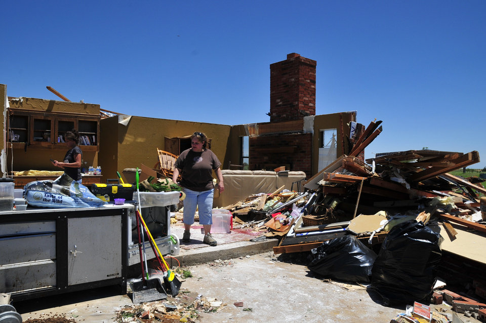 Tammy Wade looks over what is left of her home that was destroyed by Friday's tornado that ripped through El Reno Okla. Saturday June 1, 2013 in El Reno Okla.  (AP Photo/Nick Oxford) ORG XMIT: OKNO120