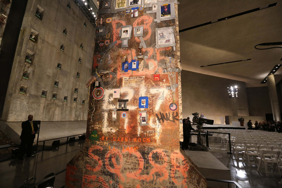 Photo - FILE- In this May 15, 2014 file photo, a steel beam from the World Trade Center stands at the center of Foundation Hall where the dedication ceremony will take place at the National September 11 Memorial Museum 2014 in New York.  With consideration given to psychological well-being of museum patrons, the museum is designed to accurately show the events of September 11, 2001, while giving those patrons  who may be too sensitive ample warning to avoid some of the more graphic exhibits. (AP Photo/The Star-Ledger, John Munson, Pool)