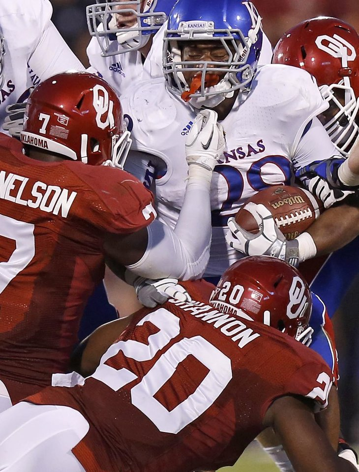 OU's Corey Nelson (7) and Frank Shannon (20) bring down KU's James Sims (29) during the college football game between the University of Oklahoma Sooners (OU) and the Kansas Jayhawks (KU) at Gaylord Family-Oklahoma Memorial Stadium in Norman, Okla., Saturday, Oct. 20, 2012. Photo by Bryan Terry, The Oklahoman