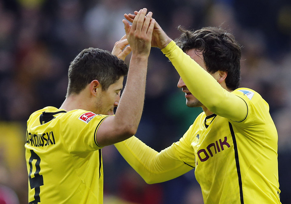 Photo - Dortmund's Robert Lewandowski of Poland, left,  and Dortmund's Mats Hummels celebrate after scoring  during the German first division Bundesliga soccer match between BvB Borussia Dortmund and 1.FC Nuremberg in Dortmund, Germany, Saturday, March 1, 2014. (AP Photo/Frank Augstein)