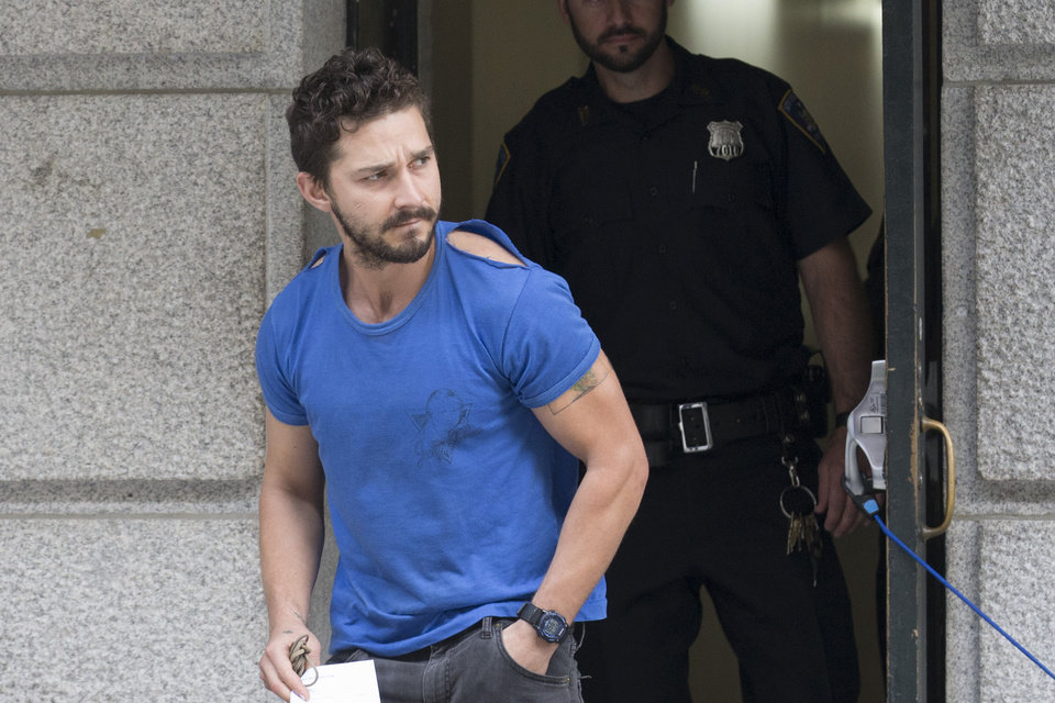 Photo - Actor Shia LaBeouf leaves Midtown Community Court after being arrested the previous day for yelling obscenities at the Broadway show