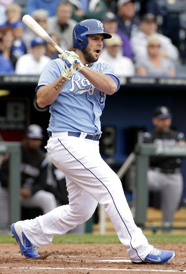 Photo - Kansas City Royals' Mike Moustakas hits a three-run double during the second inning of a baseball game against the Colorado Rockies Wednesday, May 14, 2014 in Kansas City, Mo. (AP Photo/Charlie Riedel)
