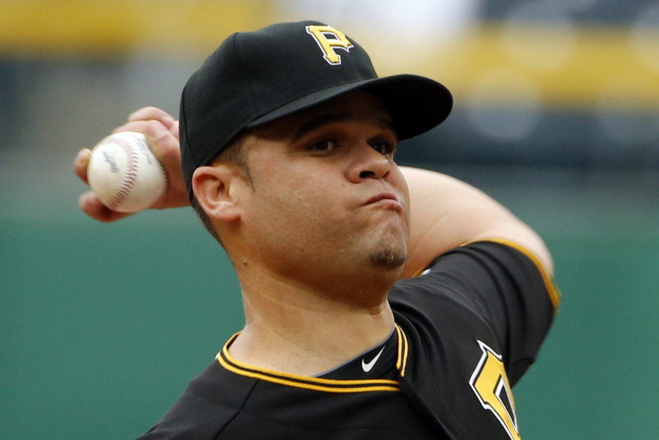 Photo - Pittsburgh Pirates starting pitcher Wandy Rodriguez delivers during the first inning of a baseball game against the Chicago Cubs in Pittsburgh, Thursday, April 3, 2014. (AP Photo/Gene J. Puskar)
