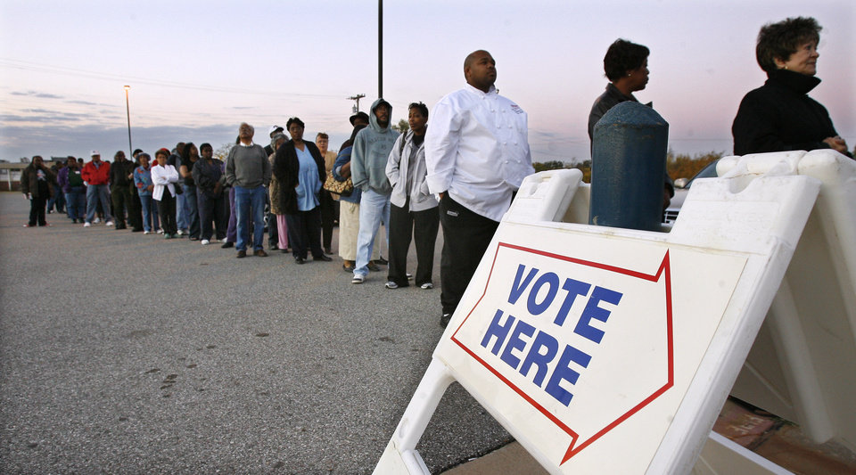Photo - Voters line up before the sun rises as they wait for precinct 551 to open to vote at precinct 551 to vote at Millwood High School in Oklahoma City Tuesday, Nov. 4, 2008. BY PAUL B. SOUTHERLAND, THE OKLAHOMAN