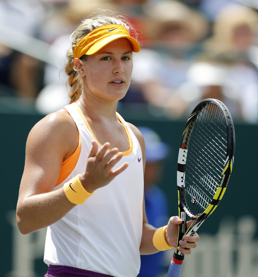 Photo - Eugenie Bouchard, of Canada, gestures during her match against Jelena Jankovic, of Serbia, during the Family Circle Cup tennis tournament in Charleston, S.C., Friday, April 4, 2014. (AP Photo/Mic Smith)