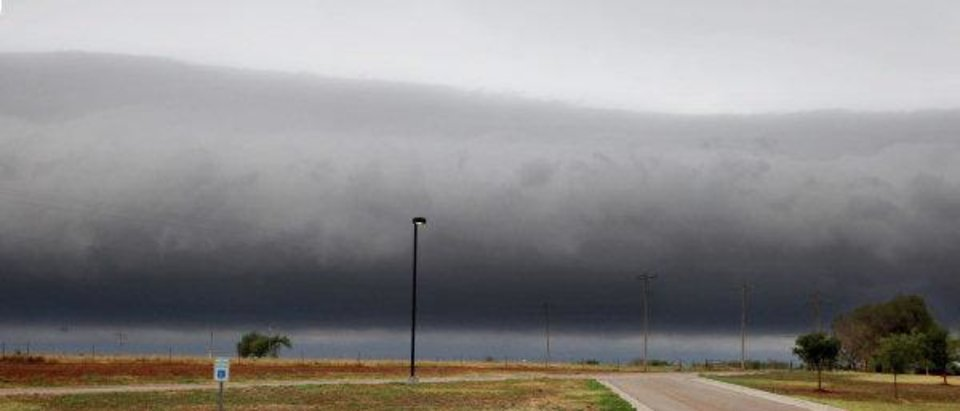 Photo - A front moves through ahead of a thunderstorm near NW 220 Street and MacArthur Ave. in Oklahoma City early Thursday morning, Aug. 11, 2011. Photo by Paul B. Southerland, The Oklahoman ORG XMIT: KOD