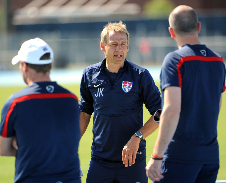 Photo - U.S.head coach Jurgen Klinsmann talks with his assistant coaches before the practice begins, Wednesday, June 4, 2014 in Jacksonville, Fla..  The team was practicing in advance of Saturday's friendly match against Nigeria, the last before the World Cup matches in Brazil. (AP Photo/The Florida Times-Union, Bob Mack)