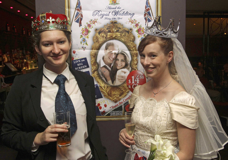 Photo - Dressed as bride and groom, Linzi Aland, right, and Arwen Whiting dress the part during a royal wedding party at the Ancient Britain (the AB) hotel in Sydney, Australia, Friday, April 29, 2011. The hotel is hosting the party during celebrations for the wedding of Prince William and Kate Middleton. (AP Photo/Rob Griffith) ORG XMIT: SYD109