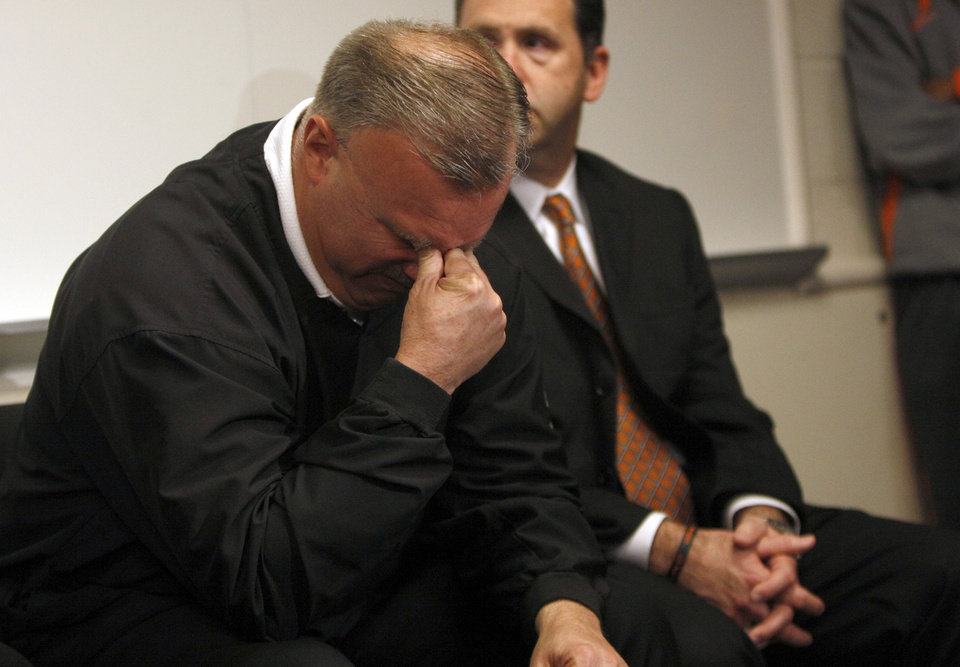 Jim Littell, associate coach for the Oklahoma State women's basketball team, reacts during a news conference in Stillwater, Okla., Friday, Nov. 18, 2011. Littell will take over coaching duties following the death of head coach Kurt Budke and assistant Miranda Serna in a plane crash. Photo by Sarah Phipps, The Oklahoman
