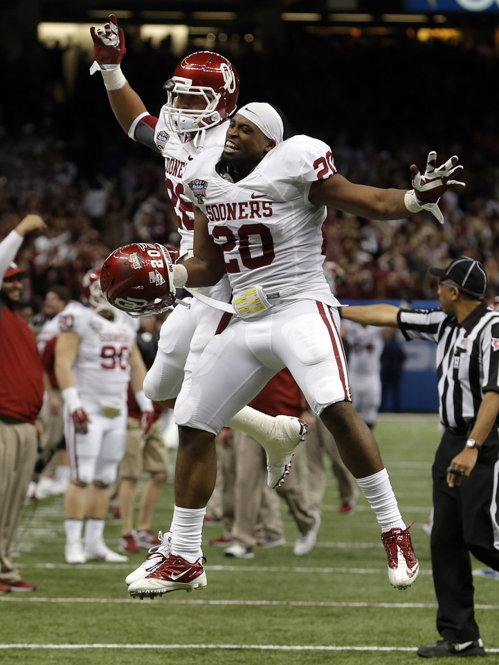 Oklahoma's Jordan Evans (26) and Frank Shannon (20) celebrate during the NCAA football BCS Sugar Bowl game between the University of Oklahoma Sooners (OU) and the University of Alabama Crimson Tide (UA) at the Superdome in New Orleans, La., Thursday, Jan. 2, 2014.  .Photo by Sarah Phipps, The Oklahoman