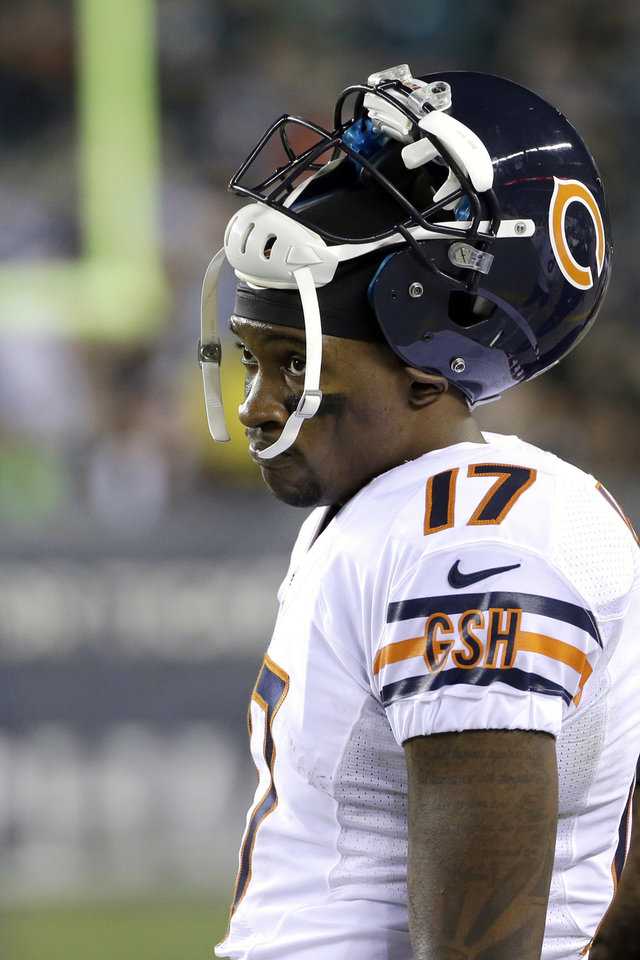 Photo - Chicago Bears' Alshon Jeffery watches from the sidelines during the second half of an NFL football game against the Philadelphia Eagles, Sunday, Dec. 22, 2013, in Philadelphia. (AP Photo/Matt Rourke)