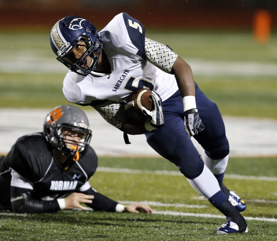 Southmoore's Pierce Spead cuts upfield as the Sabercats play Norman in high school football on Friday, Oct. 18, 2013 in Norman, Okla.  Photo by Steve Sisney, The Oklahoman