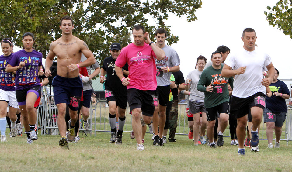 Participants begin a mud run at Mitch Park, in Edmond, OK, Saturday, September 29, 2012. The Juggernaut, as it is called, is part of a national mud run series to raise money for Susan G. Komen for the Cure. By Paul Hellstern, The Oklahoman