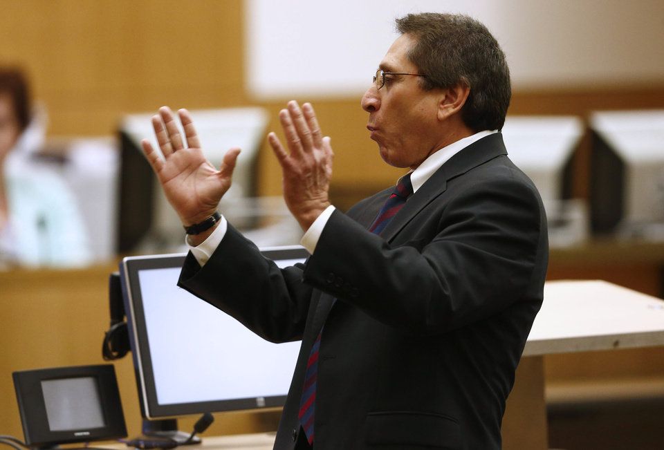 Photo - Prosecutor Juan Martinez addresses the jury on Wednesday, May 15, 2013, during the sentencing phase of the Jodi Arias murder trial at Maricopa County Superior Court in Phoenix. If the jury finds aggravating factors in her crime, Arias could be sentenced to death.   (AP Photo/The Arizona Republic, Rob Schumacher, Pool)