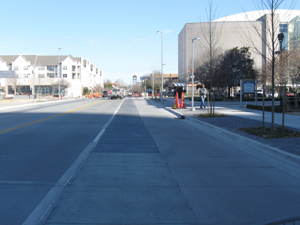 Photo -  The dedicated bike lane along Walker Avenue was removed last week by the Oklahoma City Public Works Department without prior discussion with policy makers who oversee the Project 180 program.