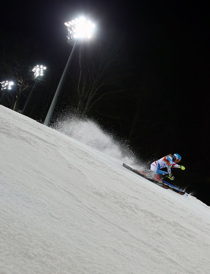 Photo - Austria's Marlies Schild skis in the second run of the women's slalom to win the silver medal in the Sochi 2014 Winter Olympics, Friday, Feb. 21, 2014, in Krasnaya Polyana, Russia.  (AP Photo/Alessandro Trovati)