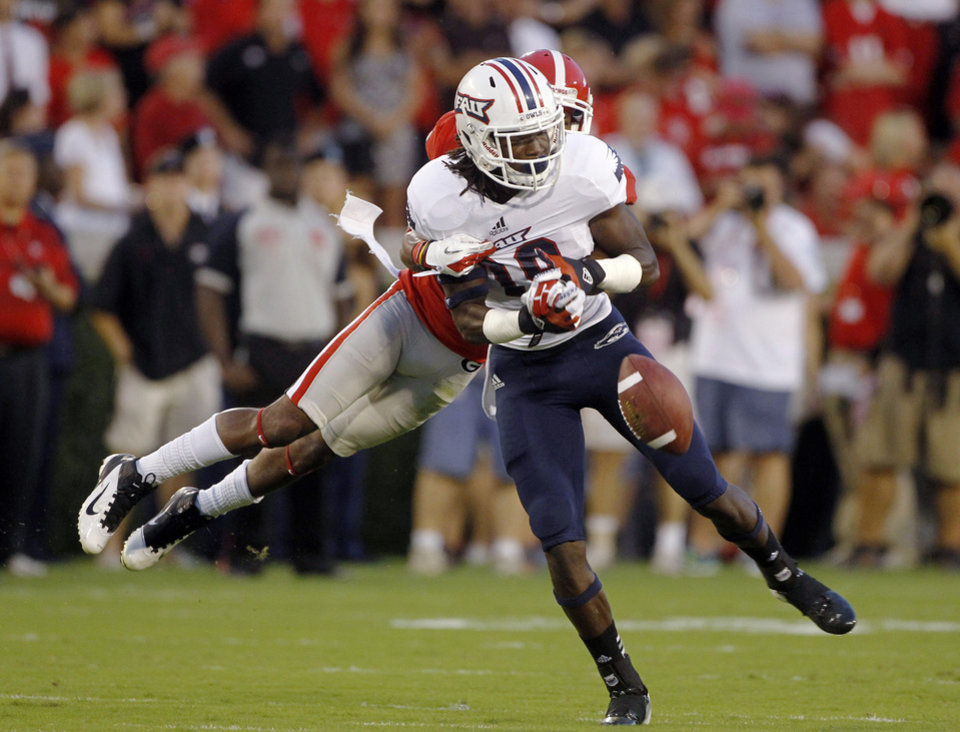 Photo -   Georgia cornerback Branden Smith (1) breaks up a pass intended for Florida Atlantic wide receiver Derek Moise (89) during the first half of an NCAA college football game Saturday, Sept. 15, 2012, in Athens, Ga. (AP Photo/John Bazemore)