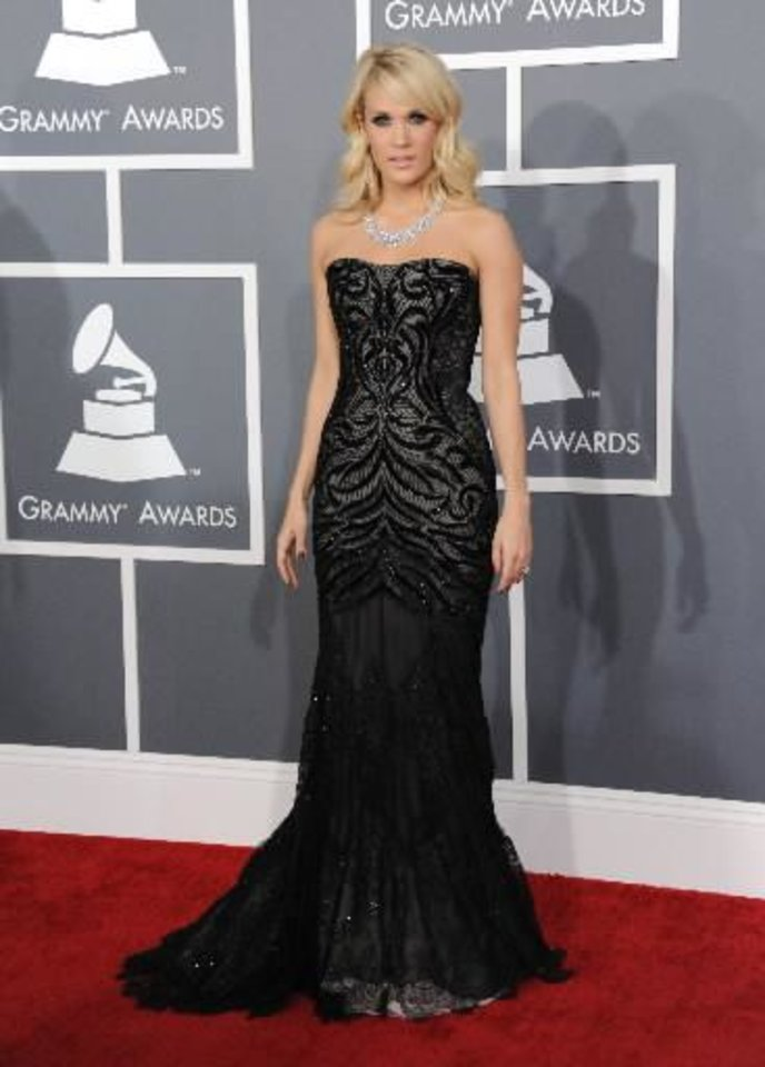 """Carrie Underwood arrives at the 55th annual Grammy Awards on Sunday, Feb. 10, 2013, in Los Angeles. Songwriters Josh Kear and Chris Tompkins won the Best Country Song Grammy for penning the Checotah native\'s hit """"Blown Away."""" (AP)"""