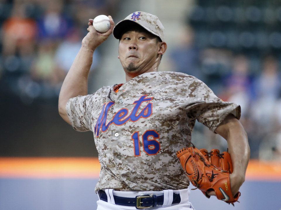 Photo - CORRECTS THAT MATSUZAKA IS A STARTING PITCHER - New York Mets starting pitcher Daisuke Matsuzaka delivers in the first inning of a baseball game against the Atlanta Braves in New York, Monday, July 7, 2014. (AP Photo/Kathy Willens)