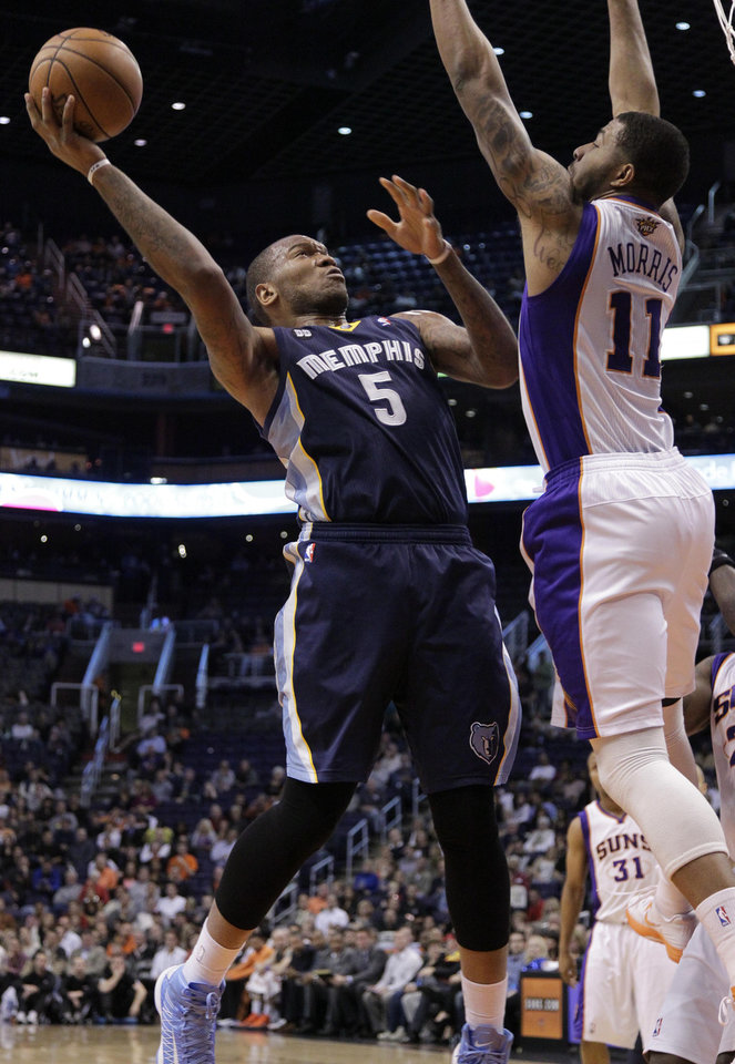 Memphis Grizzlies' Marreese Speights (5) shoots over Phoenix Suns' Markideff Morris (11)  during the first half of an NBA basketball game on Wednesday, Dec. 12, 2012, in Phoenix. (AP Photo/Matt York)