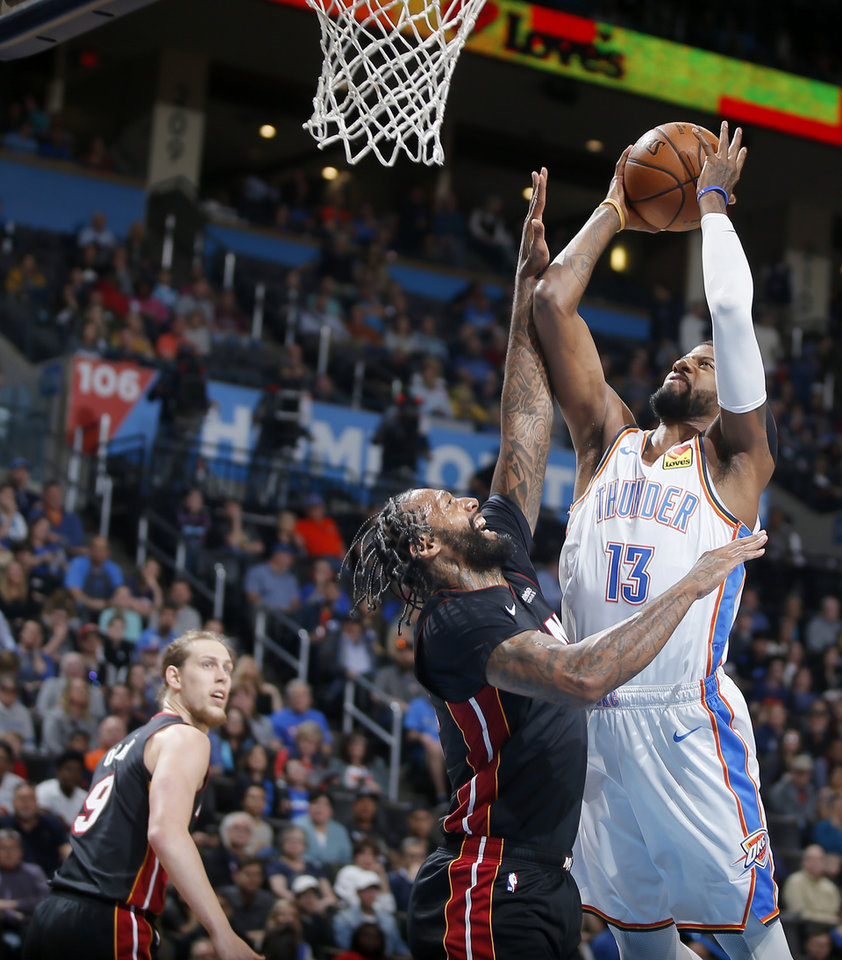 Photo - Oklahoma City's Paul George (13) puts up a shot beside Miami's James Johnson (16) during an NBA basketball game between the Oklahoma City Thunder and the Miami Heat at Chesapeake Energy Arena in Oklahoma City, Monday, March 18, 2019. Photo by Bryan Terry, The Oklahoman