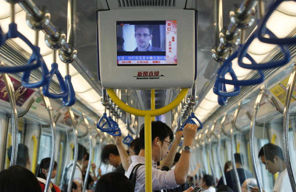 Photo -  A TV screen shows the news of Edward Snowden, a former CIA employee who leaked top-secret documents about sweeping U.S. surveillance programs, in the underground train in Hong Kong Sunday, June 16, 2013. Top U.S. intelligence officials said Saturday that information gleaned from two controversial data-collection programs run by the National Security Agency thwarted potential terrorist plots in the U.S. and more than 20 other countries — and that gathered data is destroyed every five years.  (AP Photo/Kin Cheung)