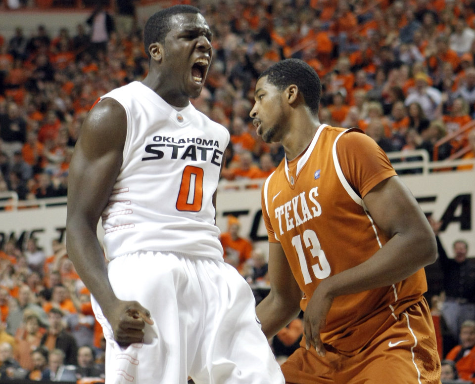 Oklahoma State's Jean-Paul Olukemi (0) celebrates in front of Texas' Tristan Thompson (13) during the basketball game between Oklahoma State and Texas, Wednesday, Jan. 26, 2011, at Gallagher-Iba Arena in Stillwater, Okla. Photo by Sarah Phipps, The Oklahoman ORG XMIT: KOD