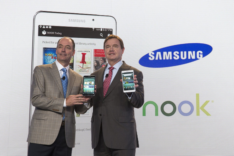 Photo - Tim Baxter, president of Samsung Electronics America, left, and Mike Huseby, CEO of Barnes & Noble, pose for a photograph during the unveiling of the Samsung Galaxy Tab 4 Nook, a co-branded tablet that will replace B&N's Nook, Wednesday, Aug. 20, 2014, in New York. The 7-inch tablet will sell for $179 after a $20 instant rebate, the same entry price of the non-branded Samsung Galaxy Tab 4. (AP Photo/John Minchillo)