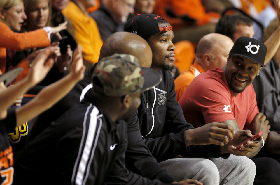 Photo - Oklahoma City's Kevin Durant watches during an NCAA college basketball game between Oklahoma State and Memphis at Gallagher-Iba Arena in Stillwater, Okla., Tuesday, Nov. 19, 2013. Photo by Bryan Terry, The Oklahoman