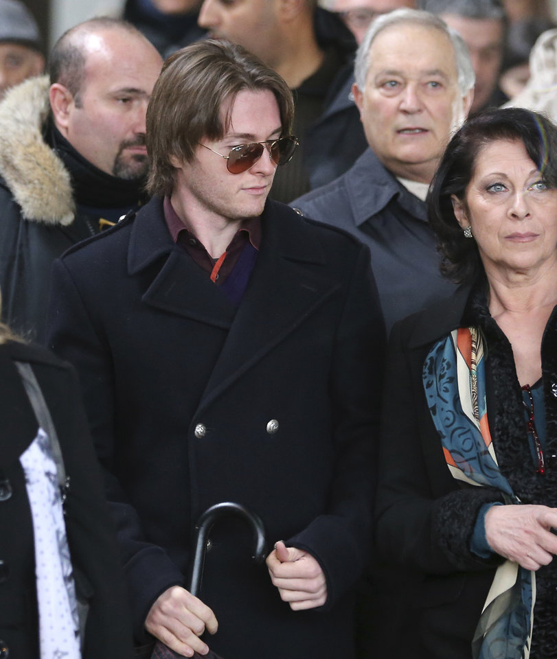 Photo - Raffaele Sollecito is flanked by his aunt Sara Achille, right, as he leaves after attending the final hearing before the third court verdict for the murder of British student Meredith Kercher, in Florence, Italy, Thursday, Jan. 30, 2014. The first two trials produced flip-flop verdicts of guilty then innocent for Kercher former roommate, American student Amanda Knox, who is not attending the hearing,  and her former Italian boyfriend, Raffaele Sollecito, and the case has produced harshly clashing versions of events. A Florence appeals panel designated by Italy's supreme court to address issues it raised about the acquittal is set to deliberate Thursday, with a verdict expected later in the day. (AP Photo/Antonio Calanni)