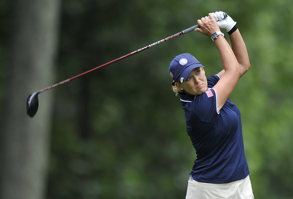 Photo - Christie Kerr  drives off the seventh hole during the first round of the International Crown golf tournament Thursday, July 24, 2014, in Owings Mills, Md.(AP Photo/Gail Burton)