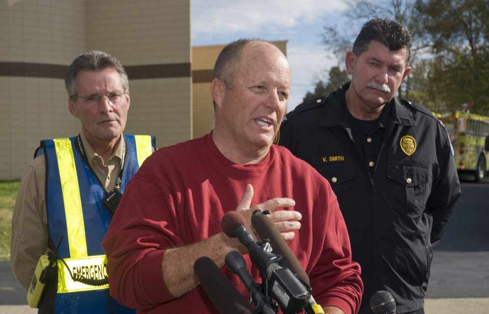 Photo -   Jerald Gupton, a representative with Paducah & Louisville Railroad speaks during a news conference Thursday, Nov. 1, 2012 at the command center at Pleasure Ridge Park Fire Station # 7 on Dixie Highway in southwest Louisville, Ky. Behind Gupton is Doug Hamilton, director of Louisville and Jefferson County Emergency Management and PRP Fire Chief Vincent Smith. A Paducah & Louisville Railway train carrying hazardous chemicals derailed just after 6 a.m. EDT Monday. A leak of a potentially explosive material was contained, but authorities say three workers were severely burned in a fire that erupted while contractors were removing debris from the train Thursday in southwest Louisville. (AP Photo/Brian Bohannon)