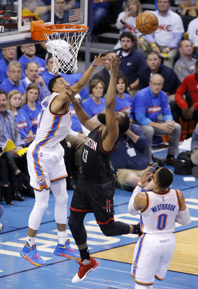 Photo - Oklahoma City's Andre Roberson (21) defends against Houston's James Harden (13) during Game 3 in the first round of the NBA basketball playoffs between the Oklahoma City Thunder and the Houston Rockets at Chesapeake Energy Arena in Oklahoma City, Friday, April 21, 2017.  Photo by Bryan Terry, The Oklahoman