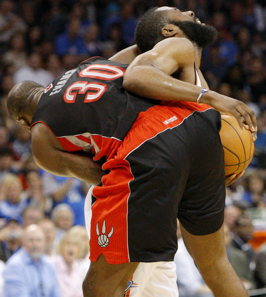 Oklahoma City's James Harden gets tangled up with Toronto's Reggie Evans during the second half of their NBA basketball game at the OKC Arena in downtown Oklahoma City on Sunday, March 20, 2011. The Raptors beat the Thunder 95-93. Photo by John Clanton, The Oklahoman