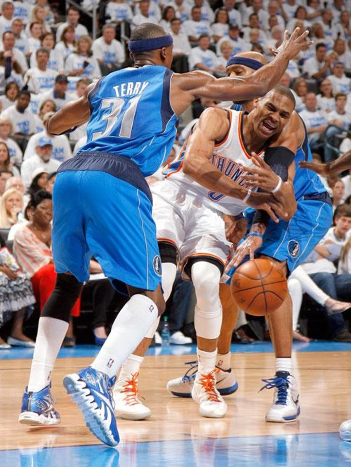 Oklahoma City's Russell Westbrook (0) tries to pass around Dallas' Jason Terry (31) and Vince Carter (25) during Game 2 of the first round in the NBA basketball playoffs between the Oklahoma City Thunder and the Dallas Mavericks at Chesapeake Energy Arena in Oklahoma City, Monday, April 30, 2012. Photo by Sarah Phipps, The Oklahoman