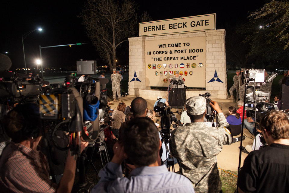 Photo - Lt. Gen. Mark Milley, commanding general of III Corps and Fort Hood, speaks with the media outside of an entrance to the Fort Hood military base following a shooting that occurred inside on April 2, 2014 in Fort Hood, TX. Four people died, including the gunman, and 16 were wounded in the attack. (AP Photo/ Tamir Kalifa)