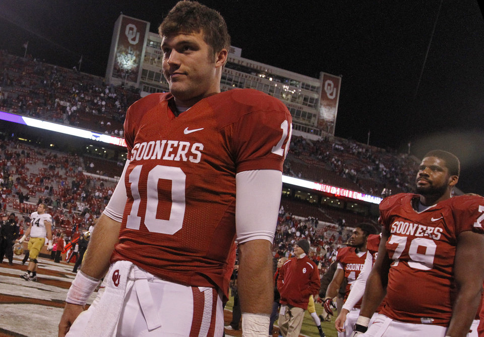 Photo - OU's Blake Bell (10) walks off the field after the 30-13 loss to Notre Dame during the college football game between the University of Oklahoma Sooners (OU) and the Notre Dame Fighting Irish at the Gaylord Family-Oklahoma Memorial Stadium on Saturday, Oct. 27, 2012, in Norman, Okla. Photo by Chris Landsberger, The Oklahoman