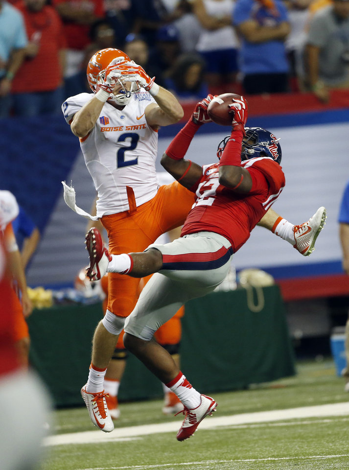 Photo - Mississippi defensive back Tony Conner (12) intercepts a pass intended for Boise State wide receiver Matt Miller (2) in the first half of an NCAA college football game  Thursday, Aug. 28, 2014, in Atlanta.  (AP Photo/John Bazemore)