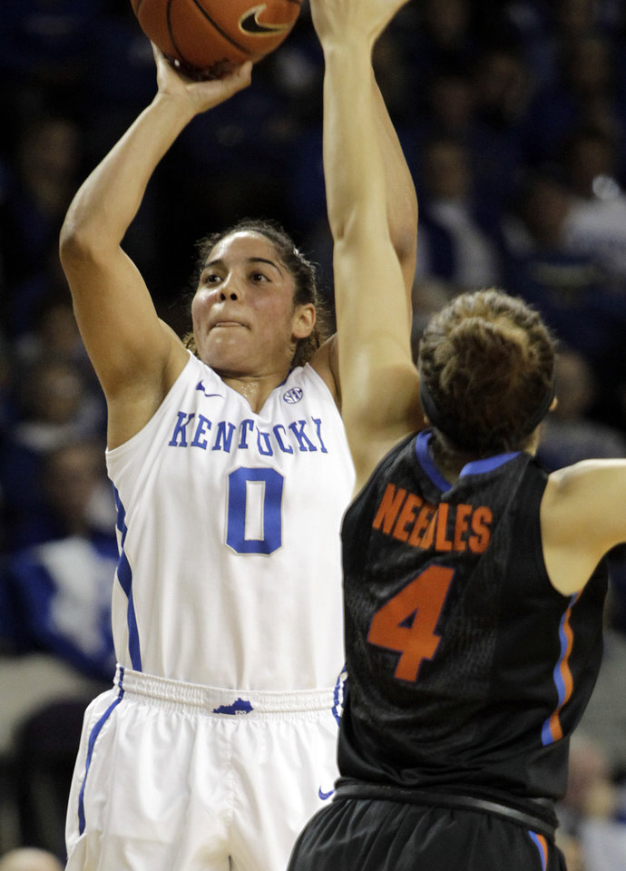 Photo - Kentucky's Jennifer O'Neill (0) shoots near Florida's Carlie Needles (4) during the first half of an NCAA college basketball game on Sunday, Jan. 5, 2014, in Lexington, Ky. (AP Photo/James Crisp)
