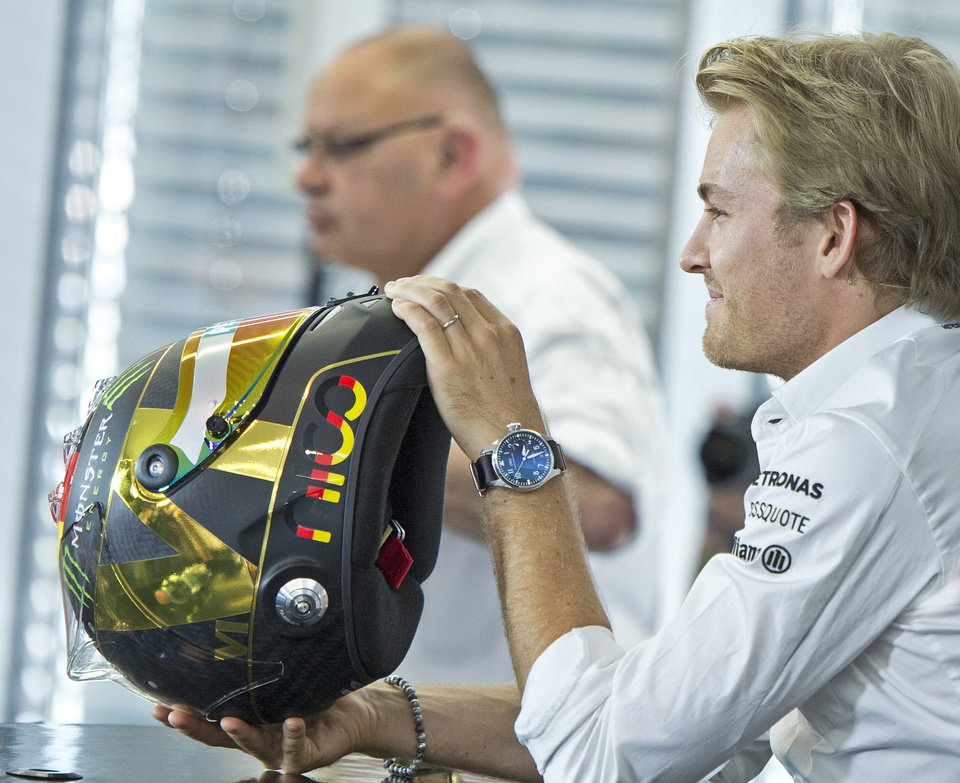 Photo - World Cup leader and Mercedes Formula One driver Nico Rosberg of Germany holds a helmet during a press conference in Hockenheim, Germany, Thursday, July 17, 2014. The German Grand Prix will be held on Sunday, July 20, 2014. (AP Photo/Jens Meyer)