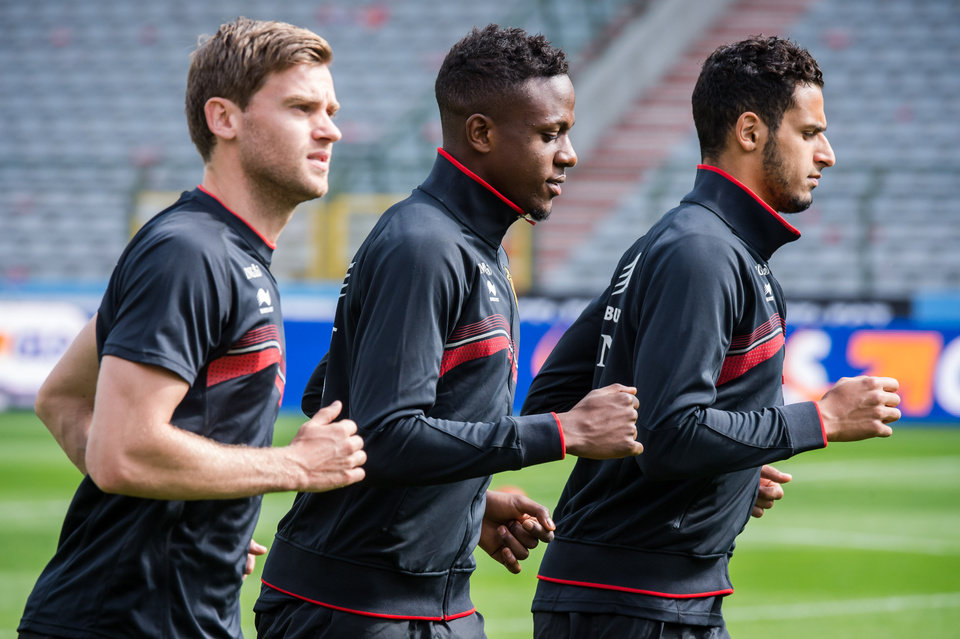 Photo - Belgium's national soccer team players Jan Vertonghen, left, Divock Origi, center, and Nacer Chadli warm up during their last training in Belgium before leaving for Brazil at the King Baudouin stadium in Brussels, Sunday June 8, 2014. Belgium will play against South Korea, Russia and Algeria in Group H of the World Cup 2014 in Brazil. (AP Photo/Geert Vanden Wijngaert)