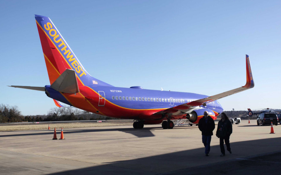 Photo - Southwest Airlines Flight 4013 sits at the M. Graham Clark Downtown Airport in Hollister, Mo., Monday, Jan. 13, 2014. The plane was supposed to land at the nearby Branson Airport on Sunday evening, but instead landed at Clark Airport, also known as Taney County Airport, which has a much shorter runway than at Branson, about 7 miles away. (AP Photo/Springfield News-Leader, Valerie Mosley)