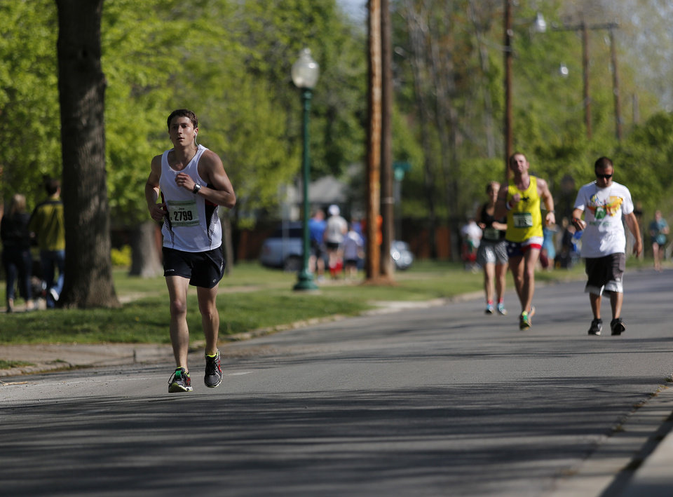 Runners go south on Shartel just past mile 24 in Heritage Hills during the Oklahoma City Memorial Marathon in Oklahoma City, Sunday, April 28, 2013.  Photo by Garett Fisbeck, For The Oklahoman