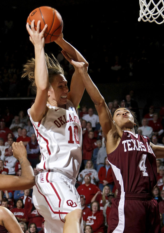 Photo - OU's Carlee Roethlisberger (10) grabs a rebound in front of Texas A&M's Sydney Carter (4) during the Big 12 women's basketball game between the University of Oklahoma and Texas A&M at Lloyd Noble Center in Norman, Okla., Wednesday January 26, 2011.  Photo by Bryan Terry, The Oklahoman