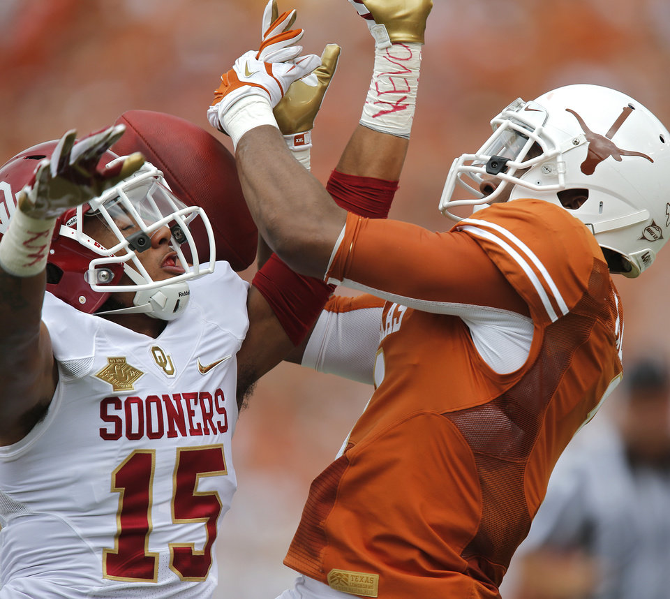 OU's Zack Sanchez (15) breaks up a pass for UT's Mike Davis (1) during the Red River Rivalry college football game between the University of Oklahoma Sooners (OU) and the University of Texas Longhorns (UT) at the Cotton Bowl Stadium in Dallas, Saturday, Oct. 12, 2013. Photo by Chris Landsberger, The Oklahoman