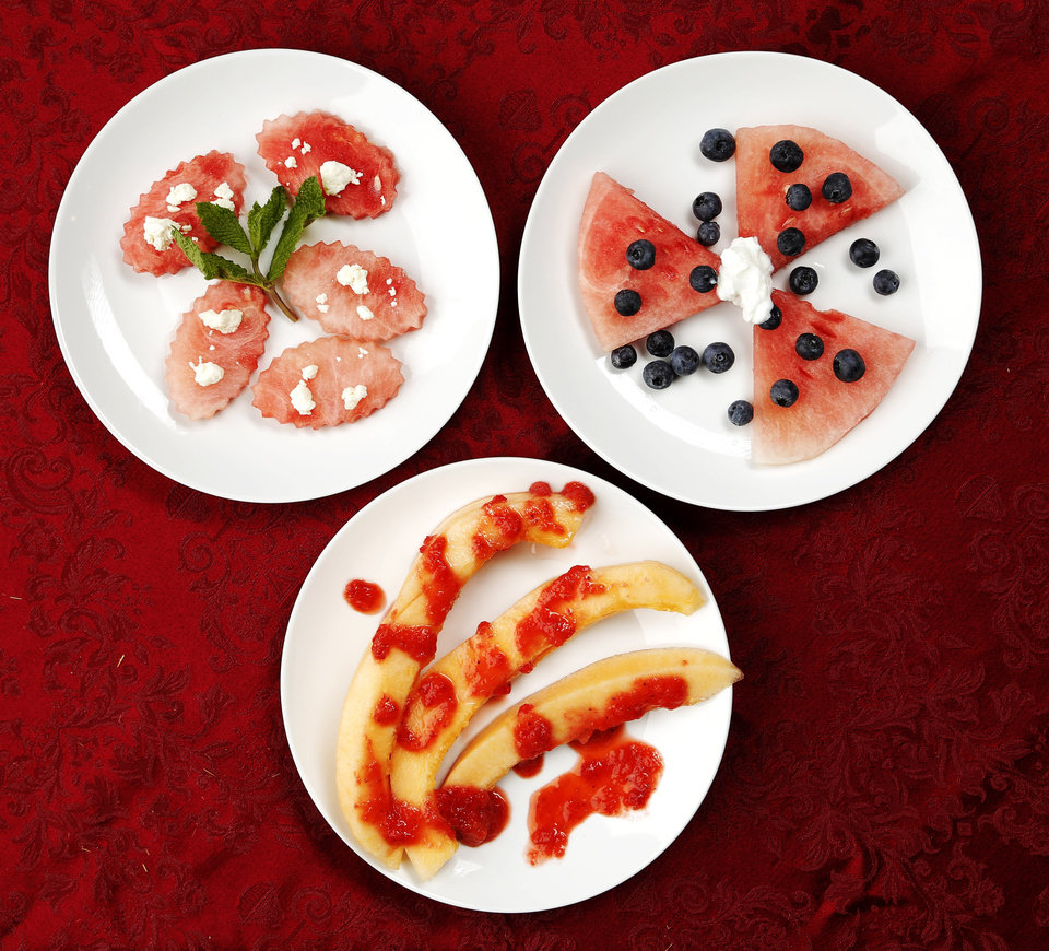 Photo -  Melons can be prepared many ways, including, clockwise from top left, watermelon topped with feta cheese, watermelon accompanied by blueberries and fat-free Greek yogurt, or cantaloupe drizzled with strawberry puree. Photo by Doug Hoke, The Oklahoman   DOUG HOKE -  THE OKLAHOMAN