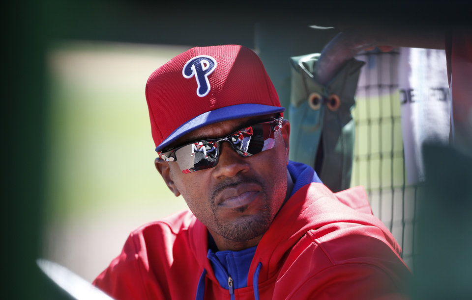 Photo - Philadelphia Phillies Jimmy Rollins sits in the dugout during a spring exhibition baseball game against the New York Yankees in Clearwater, Fla., Thursday, March 13, 2014.  Rollins, who did not play for the third consecutive game, said the situation was unusual and that he is healthy, therefore he is not sure why manager Ryne Sandberg is not playing him. (AP Photo/Kathy Willens)