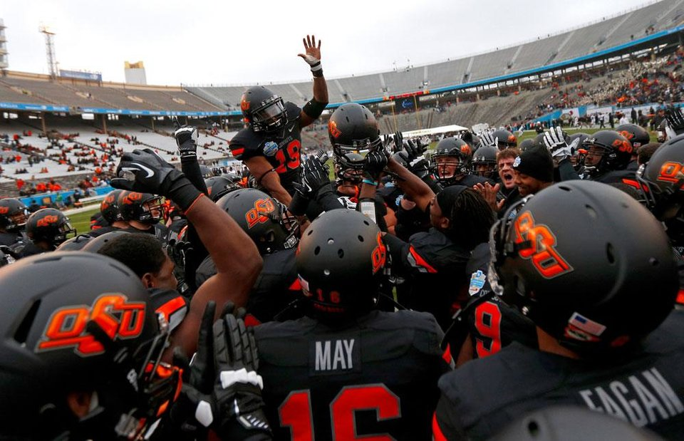 The Oklahoma State team gathers before the Heart of Dallas Bowl football game between Oklahoma State University and Purdue University at the Cotton Bowl in Dallas, Tuesday, Jan. 1, 2013. Photo by Bryan Terry, The Oklahoman