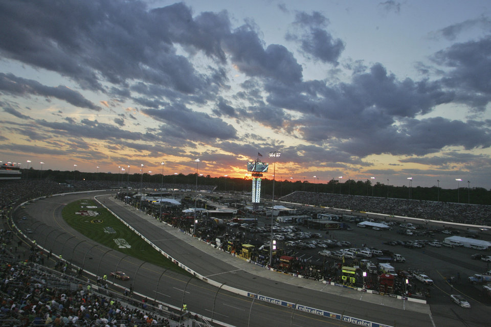 Photo - The sun sets behind the scoreboard during the NASCAR Sprint Cup auto race at Richmond International Raceway in Richmond, Va., Saturday, April 26, 2014. (AP Photo/Jason Hirschfeld)